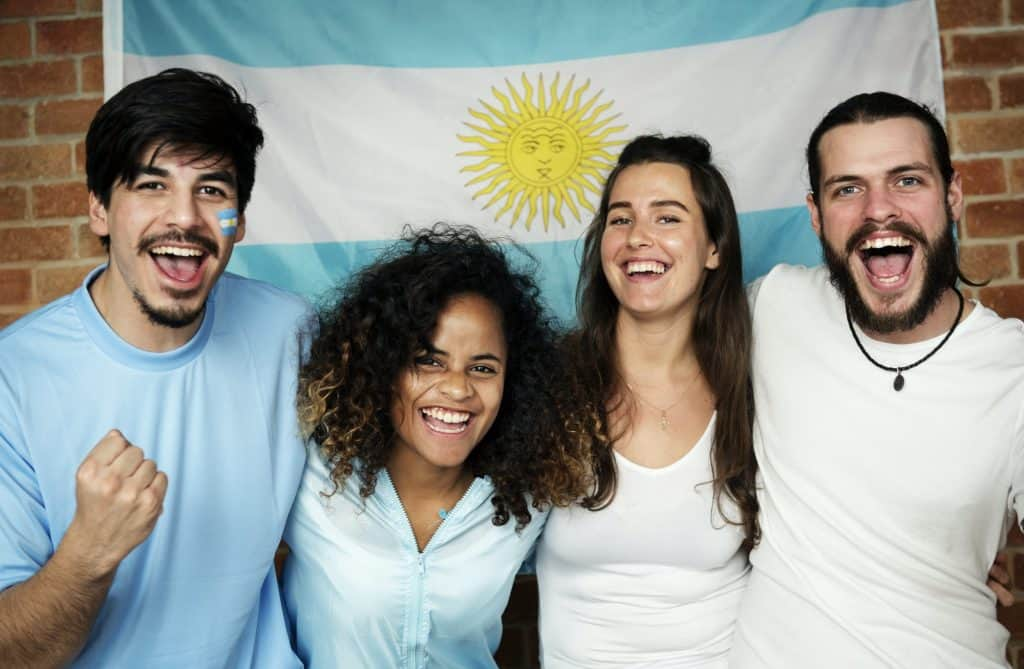 Friends cheering world cup with painted flag